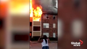 Dramatic footage shows residents jumping from window onto mattresses to escape apartment fire in Dallas