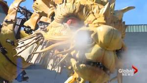Giant mechanical dragon and spider walk through the streets of Ottawa (01:15)