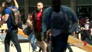 People flee scene of shooting near Nathan Phillips Square during Raptors championship parade