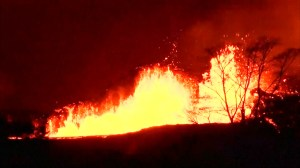 Lava flows through Hawaii community as first serious injury from Kilauea volcano reported