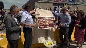 Plaque unveiled to remember killed gas station worker