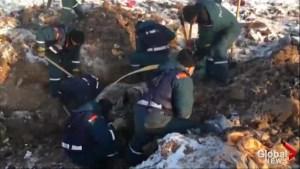 Russian investigators pouring over debris at site of deadly plane crash