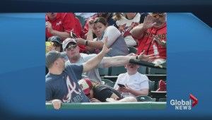 Fan's big league play saves kid from flying bat at spring training game