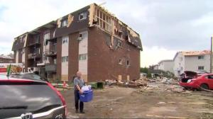 Demolition work begins on tornado-ravaged homes