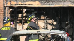 Fire investigators look through charred remains of west Lethbridge home