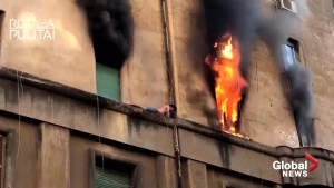 Man clings to side of burning building for dear life in Rome