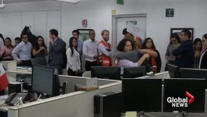Video taken inside office building in Mexico City shows employees reacting as quake hit