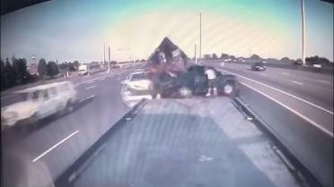 Dramatic video shows car smashing into crashed vehicle at side of