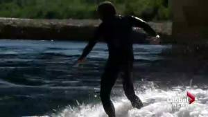 River surfers catching a wave in Calgary