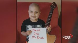 Cancer free announcement upstages Garth Brooks concert