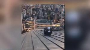 Vancouver police investigate man sliding down skyscraper roof