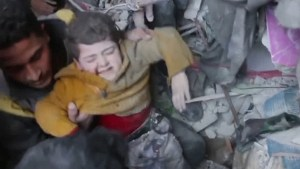 Boy pulled from rubble alive as relentless airstrikes in East Ghouta continue