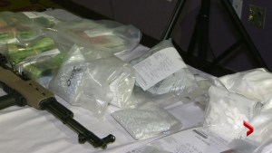 Police arrest 18 people connected to drug and weapons trafficking in Ontario-Quebec