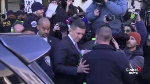 Michael Flynn leaves court after judge delays sentencing