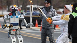 Robots take part in Olympic torch relay in South Korea