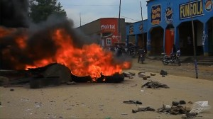 Tires burn as protests over Congo presidential election heat up over voting delay due to Ebola outbreak