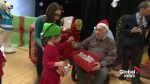 Students get presents from Generations Foundation toy drive