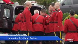 Pallbearers carry Cst. Beckett's casket into Westhills Stadium