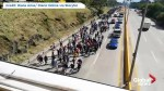 Amateur video shows group of migrants departing El Salvador for the U.S.