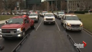 Tow truck operators stage massive protest at Queen's Park with vehicles