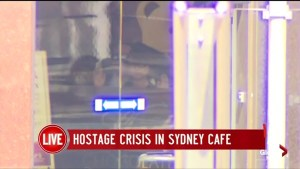 Footage shows Australia gunman walking by window with hostage