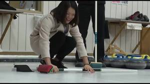Fleming College international students learn curling at Peterborough Curling Club
