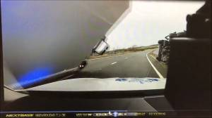 Police officer has lucky escape as truck falls onto patrol car