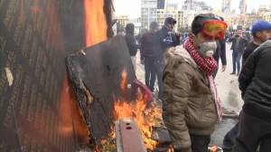 Lebanon protesters clash with security, demand elections ahead of confidence vote
