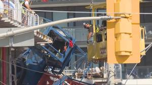 Search for cause in place after a crane collapsed in downtown Toronto