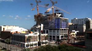Implosions bring down cranes looming over partially collapsed New Orleans hotel construction site