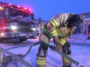 Edmonton firefighters battle blaze at home amid frigid temperatures