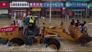 Rescues continue in China's Henan province amid heavy flooding (01:21)