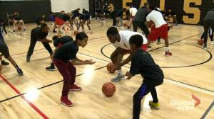 Raptors shoot hoops with aspiring players at Toronto community centre