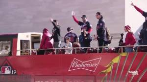 Washington Nationals wave to fans as they make their way down championship parade route