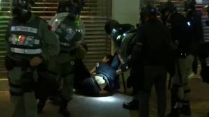 Police in Hong Kong use tear gas, arrest at least 1 protester as demonstrations enter 22nd week