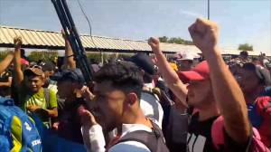 Clashes break out between police, migrants stranded in between Guatemala and Mexico