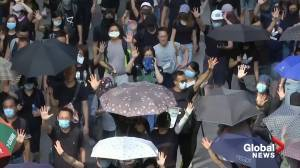 Defiant mask-wearing protesters return to Hong Kong streets after night of violence