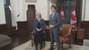 May meets with Trudeau, calls for changes to emissions