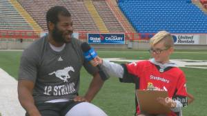Junior reporter Cole interviews Stamps defensive lineman Folarin Oriomade