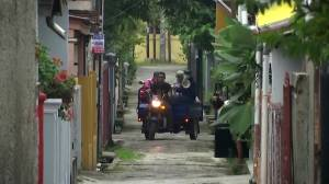 Coronavirus outbreak: Doctor in Indonesia shouts COVID-19 advice from a tricycle
