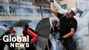 Hong Kong police fire tear gas during protests against smart lampposts