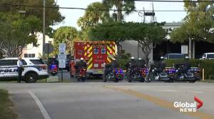 2 FBI officers killed in shooting honoured with procession on way to medical examiner's office (00:40)