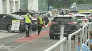 Montreal's Circuit Gilles Villeneuve vaccination site opens to motorists (01:46)