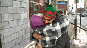 Local Montreal cafe spreads holiday love with free hugs (01:30)