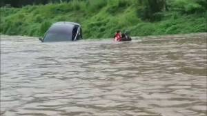 Woman rescued from submerged car amid deadly South Korea floods