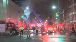 Fire crews tackle four-alarm blaze in Toronto that sent 2 firefighters to hospital