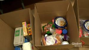 The United Irish Societies prepare Christmas baskets for families in need