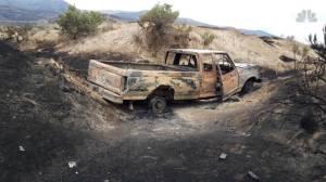 Daring wildfire rescue caught on camera