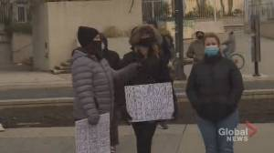 Protesters demand defunding police in front of Hamilton city hall (01:24)