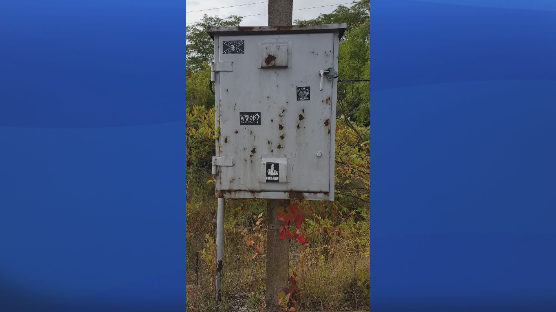 Police investigate after hate-based stickers found across Owen Sound